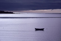 Lone Boat Moored at Twilight Stock Photography