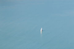 Lone boat in the ocean Royalty Free Stock Photos