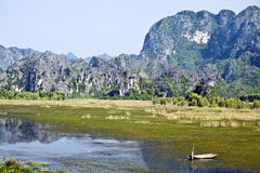 Lone Boat in Reflections of Ninh Binh Royalty Free Stock Images