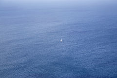 A lone boat sailing the ocean Stock Photo