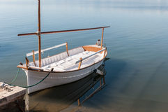 Lone boat tied to the dock Stock Photos