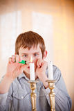 Lone boy lighting candles Royalty Free Stock Images