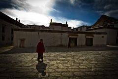 A lone Buddhist monk of Tashilompu Monastery Shigaste Tibet Royalty Free Stock Image