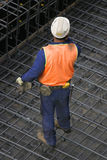 Lone Builder. One builder standing on wire mesh Stock Photography