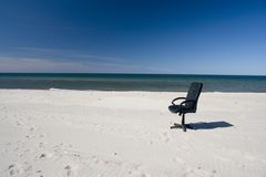 Lone business chair on beach royalty free stock photo