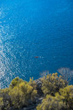 Lone Canoe  off the coast of Kas, Turkey. Seen from the Lycian Way Royalty Free Stock Image