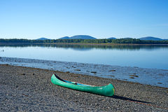 Lone canoe on shore Royalty Free Stock Images