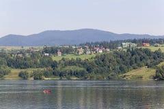 Lone canoeist on the lake Czorsztynskie, Poland Royalty Free Stock Photography