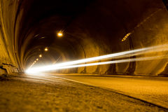 Lone car moving fast in tunnel. Low angle view Royalty Free Stock Images