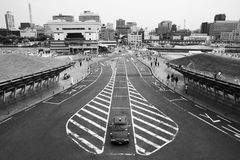 Lone Car in Yokohama. A picturesque view of Yokohama with a taxi waiting for passengers. Presenting in black and white to bring out the contrast of texture and Stock Photo