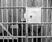 Lone cell. Black and white image of an old prison cell Royalty Free Stock Photography