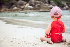 Lone child looking into the distance rear view with copy space and blurred background Royalty Free Stock Image