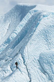 Lone climber looking to the top of glacier Royalty Free Stock Photos