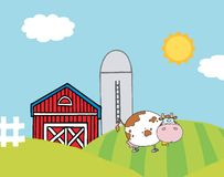 Lone cow on a hill near a silo and barn Royalty Free Stock Image