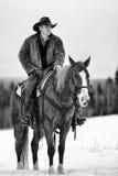 Lone cowboy in horse. A horse wrangler riding solo on horse in mountains stock photos