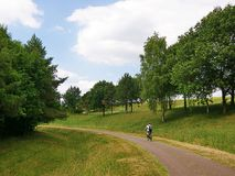 Lone cyclist in countryside Stock Photos