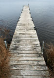 Lone Dock. Old Dock over lake in winter stock image