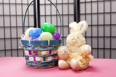 Sad egg on bunny's lap. Stock Images