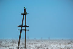 Lone electric pole on the background of a winter landscape royalty free stock photos