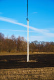 Lone electric pole on the meadow Royalty Free Stock Image