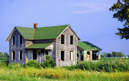 Lone Farmhouse. Abandoned farmhouse along a rural highway Royalty Free Stock Photography