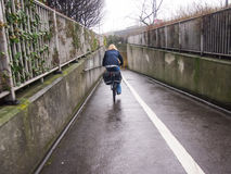 Lone female cyclist in an urban underpass Stock Images