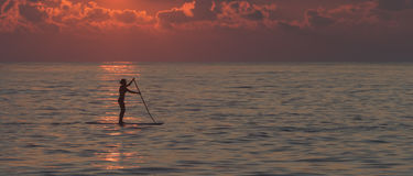 Lone female paddleboarder  Stock Photos