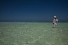 Lone figure on beach in Michamwi-Pingwe Zanzibar, Stock Photos