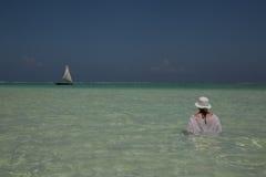 Lone figure on beach in Michamwi-Pingwe Zanzibar, Royalty Free Stock Image