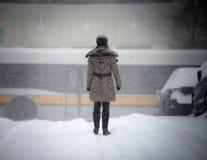 Lone Figure in the Urban Snow Stock Photo