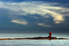 Lone fisherman royalty free stock images