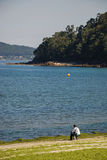 Lone fisherman. On a beach in northern Spain Royalty Free Stock Image