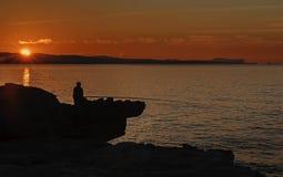 Lone fisherman Royalty Free Stock Photo