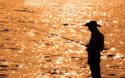 Lone fisherman during late hours Royalty Free Stock Photography