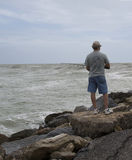 Lone Fisherman. One of many fishermen at the Jetty in Venice Beach Florida Stock Photography