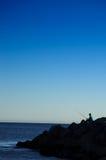 lone fisherperson arkivfoton