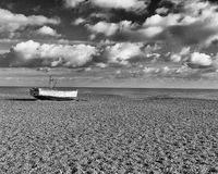 Lone Fishing Boat, Aldeburgh, Suffolk, England. A lone fishing boat on Aldeburgh beach, Suffolk, England stock photo