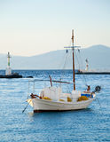 Lone fishing boat at anchor in the sea Stock Photo