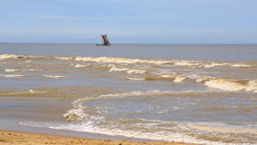 A lone fishing boat floats. But the ocean stock footage