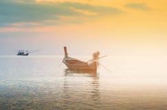 Lone fishing boat over seacoast skyline. Natural landscape background stock images