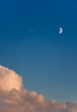 Lone half Moon  high in the sky Royalty Free Stock Image