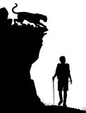 Lone hiker. Editable vector silhouette of a lone hiker being stalked by a cougar Stock Photo