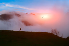 Lone hiker in the mountains at sunset Royalty Free Stock Photo