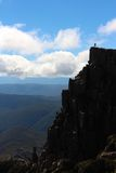 Lone hiker on the the peak of Cradle mountain Stock Image