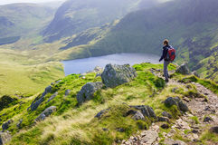 A lone hiker walking in the Lake District Royalty Free Stock Photo