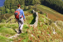 A lone hiker walking in the Lake District Royalty Free Stock Photos