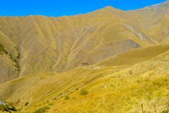 Lone house in the middle of caucasus mountains. Stock Photography