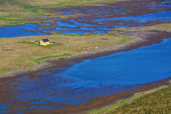 Lone house in marshes. Lone house in swamps on norwegian island of Vaeroy, Lofoten Stock Images