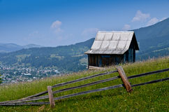 A lone house on top of the mountains Stock Images