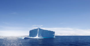 Lone iceberg drifting in ocean Royalty Free Stock Images